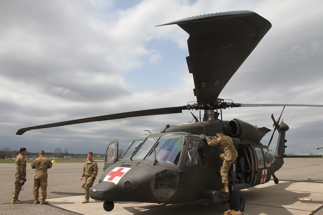 Soldiers stand by a medical evacuation helicopter.