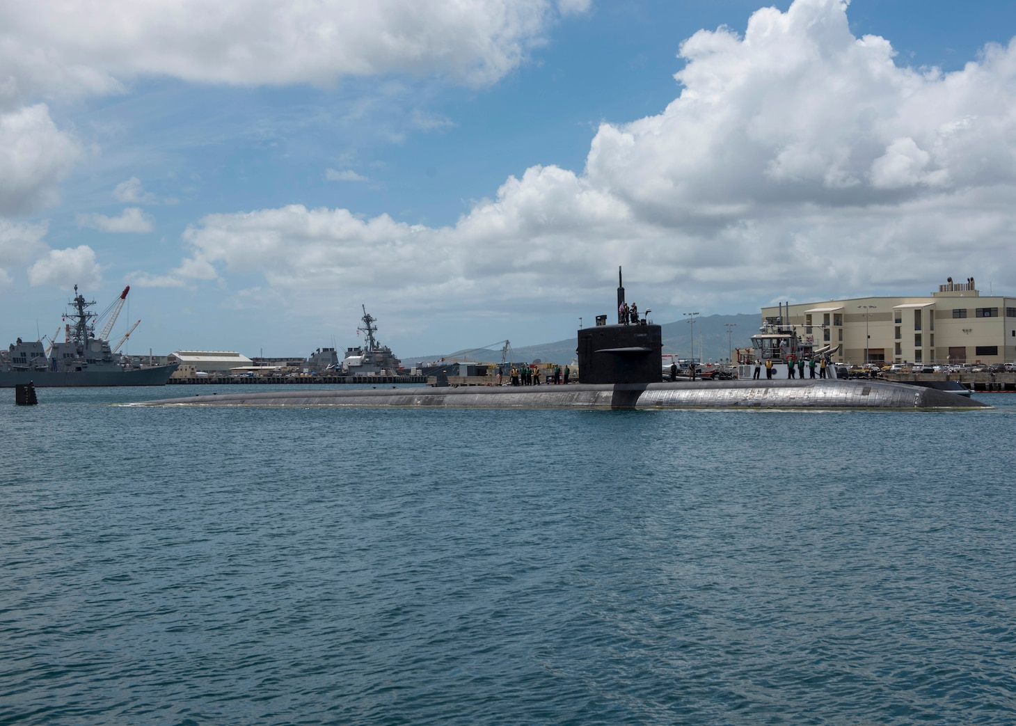 PEARL HARBOR (April 20, 2018) The Los Angeles- class fast-attack submarine USS Bremerton (SSN 698) departs Joint Base Pearl Harbor-Hickam for the final time, April 20.(U.S. Navy Photo by Mass Communication Specialist 2nd Class Shaun Griffin/Released)