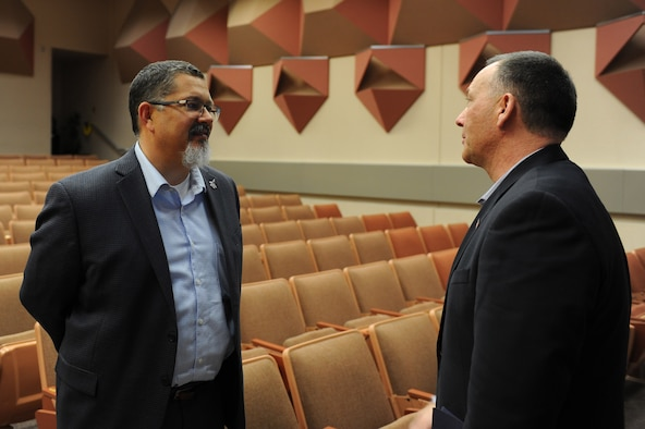 Jeff Stepp, the special assistant to the Mayor of the Fairbanks North Star Borough, speaks with Kevin Blanchard, the 354th FW F-35 PIO director, after a briefing about FNSB growth to support the F-35 bed down April 18, 2018, at Eielson Air Force Base, Alaska. The final recommendations for the FNSB will be released by the Arcadis Project Team later this week. (U.S. Air Force photo by Airman 1st Class Eric M. Fisher)