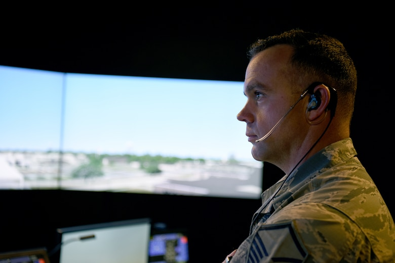 U.S. Air Force Master Sgt. Brian Cloutier, 81st Training Wing protocol NCO in charge, looks at a simulated runway in the air traffic control tower simulator at Keesler Air Force Base, Mississippi, March 28, 2018. Cloutier, a former air traffic controller of 13 years, has been recently selected to become a remotely piloted aircraft pilot. (U.S. Air Force photo by Airman 1st Class Suzie Plotnikov)