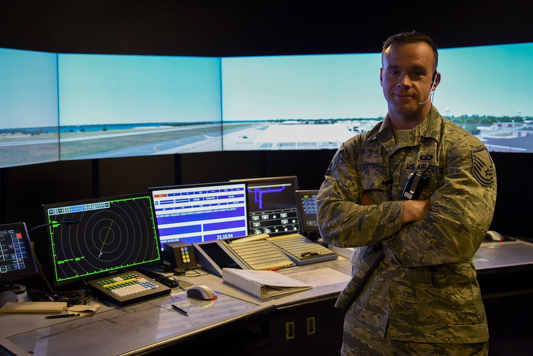 U.S. Air Force Master Sgt. Brian Cloutier, 81st Training Wing protocol NCO in charge, poses for a photo in the air traffic control tower simulator at Keesler Air Force Base, Mississippi, March 28, 2018. Cloutier, a former air traffic controller of 13 years, has been recently selected to become a remotely piloted aircraft pilot. (U.S. Air Force photo by Airman 1st Class Suzie Plotnikov)