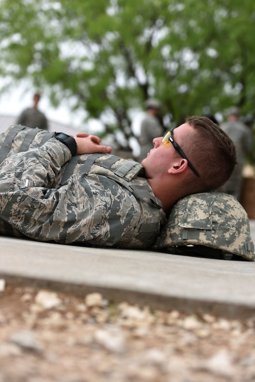 Wallace Good, Angelo State University Air Force ROTC cadet, takes a moment to catch up on his sleep during the training exercise at the mock forward operating base on Goodfellow Air Force base, Texas, April 20, 2018. According to Lt. Col. Shane Bertolio, Angelo State University ROTC detachment commander, the cadets averaged two hours of sleep during the exercise. (U.S. Air Force photo by Airman 1st Class Seraiah Hines/Released)