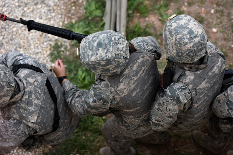 Air Force ROTC Cadets from San Angelo State University prepare to charge and clear a structure during the training exercise held at the mock forward operating base on Goodfellow Air Force Base, Texas, April 20, 2018. The cadets had to work as a team and learn effective communication before being allowed to move onto other points of training. (U.S. Air Force photo by Airman 1st Class Seraiah Hines/Released)