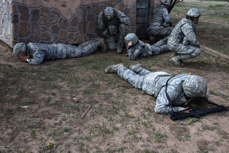 Angelo State University Air Force ROTC cadets go prone after hearing a simulated bomb go off at the mock forward operating base on Goodfellow Air Force Base, Texas, April 21, 2018. The cadets participated in exercises which involved using leadership skills to properly execute a variety of missions. (U.S. Air Force photo by Airman 1st Class Seraiah Hines/Released)