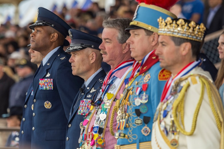 """Military and civilian personnel stand at Joint Base San Antonio-Lackland, Texas during a Basic military training graduation ceremony April 20, 2018. The ceremony also acknowledged the beginning of """"Fiesta San Antonio,"""" the city's annual festival held to honor the memory of the battles of the Alamo and San Jacinto. (U.S. Air Force photo by Ismael Ortega / Released)"""
