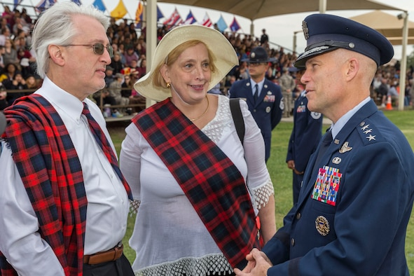 David Lackland (Left) and his wife Eileen are greeted by Lt. Gen. Steven L. Kwast (Right), Commander of the Air Education and Training Command at Joint Base San Antonio-Lackland, Texas during a basic military training graduation ceremony April 20, 2018. David is the cousin of Brig. Gen. Frank D. Lackland, the namesake of JBSA-Lackland. Today is the first time David and Eileen have viewed a BMT graduation. (U.S. Air Force photo by Ismael Ortega / Released)