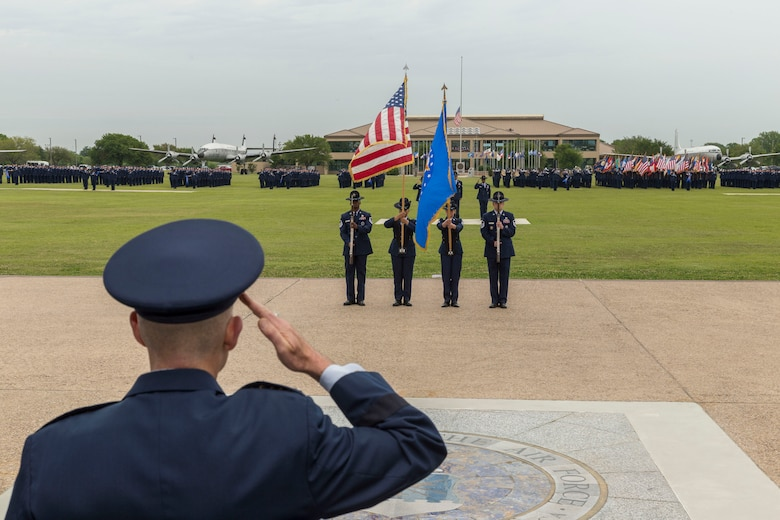 """Lt. Gen. Steven L. Kwast (Left), Commander of the Air Education and Training Command salutes at Joint Base San Antonio-Lackland, Texas during a basic military training graduation ceremony April 20, 2018. The ceremony also acknowledged the beginning of """"Fiesta San Antonio,"""" the city's annual festival held to honor the memory of the battles of the Alamo and San Jacinto. (U.S. Air Force photo by Ismael Ortega / Released)"""