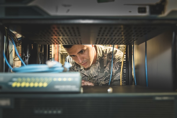 U.S. Air Force Staff Sgt. Charles Chalk, cable and antenna technician from the 202d Engineering Installation Squadron (EIS), Georgia Air National Guard (ANG), evaluates data rack mounted communications equipment at Muñiz ANG Base in San Juan, Puerto Rico, April 19, 2018. The 202d EIS deployed to the Puerto Rico Air National Guard's 156th Airlift Wing as part of the Hurricane Irma and Maria recovery efforts to spearhead a large-scale project relocating communications systems cabling and equipment to a new hardened facility. The total project will be a collaborative effort between ANG EIS units, military civil engineer teams, 156th Communications Flight, Defense Information Systems Agency and commercial service providers, meant to provide a cost-effective solution to bolster and protect the communication infrastructure for the 156th AW. (U.S. Air National Guard photo by 2nd Lt. Ronald Cole)
