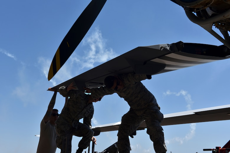 Maintenance Airmen assigned to the 432nd Aircraft Squadron prepare the Air Force's only MQ-9 Reaper model static display for the 2018 Air and Space Expo season April 20, 2018 at Columbus Air Force, Mississippi. Aircrew, crew chiefs, intelligence and public affairs Airmen informed community leaders and military supporters of the contributions of Remotely Piloted Aircraft at the Wings Over Columbus Air and Space Expo April 21, kicking off the 2018 season. (U.S. Air Force photo by 1st Lt. Annabel Monroe)