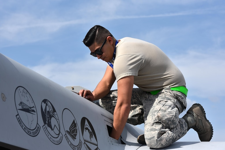 Airman 1st Class Anthony, assigned to the 432nd Aircraft Squadron, prepares the Air Force's only MQ-9 Reaper model static for display for the Air and Space Expo season April 20, 2018 at Columbus Air Force, Mississippi. The build requires eight to ten maintenance Airmen and the appropriate equipment to complete. (U.S. Air Force photo by 1st Lt. Annabel Monroe)