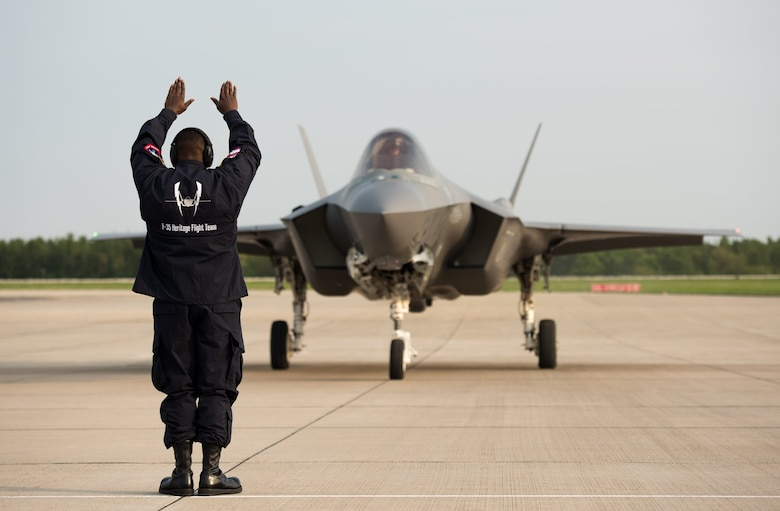 Staff Sgt. Ivan Sumter, F-35 Heritage Flight Team crew chief, marshalls in an F-35A Lightning II upon arrival for the 2018 Berlin Air and Trade Show at the Berlin Schönefeld Airport, in Berlin, Germany, April 22, 2018. The Berlin Air and Trade Show provides an invaluable forum to demonstrate the types of weapons and technology that promote the goals of enhancing the security of our allies and improving interoperability. (U.S. Air Force photo by Airman 1st Class Alexander Cook)