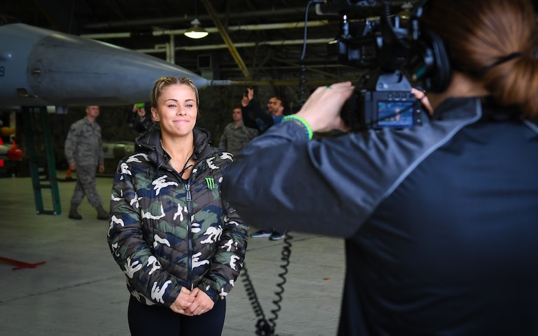 Ultimate Fighting Championship fighter Paige VanZant answers questions from a USO videographer during a tour at Osan Air Base, April 23, 2018.