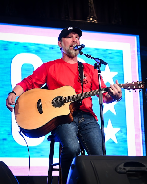 Award-winning country music singer and U.S. Army veteran Craig Morgan performs before a crowd during a USO tour at Osan Air Base, Republic of Korea, April 23, 2018.