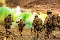 U.S. Marines assigned to Fox Company, Battalion Landing Team, 2nd Battalion, 6th Marine Regiment, 26th Marine Expeditionary Unit, run to firing positions during live-fire training in Jordan as part of Eager Lion 2018. Eager Lion is a capstone training engagement that provides U.S. forces and the Jordan Armed Forces an opportunity to rehearse operating in a coalition environment and to pursue new ways to collectively address threats to regional security and improve overall maritime security.