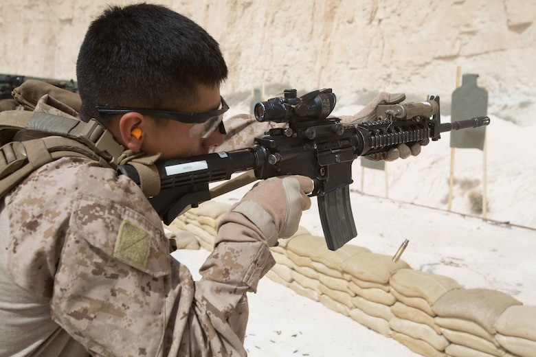 A U.S. Marine assigned to the Maritime Raid Force, 26th Marine Expeditionary Unit, fires an M4A1 carbine rifle during a 25 meter range as part of Eager Lion at the King Abdullah II Special Operations Training Center, Amman, Jordan, April 20, 2018. Eager Lion is a capstone training engagement that provides U.S. forces and the Jordan Armed Forces an opportunity to rehearse operating in a coalition environment and to pursue new ways to collectively address threats to regional security and improve overall maritime security.