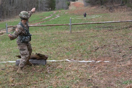 Sgt. 1st Class Eric Ojeda, from the 94th Training Division, throws a hand grenade as part of the 80th Training Command's 2018 Best Warrior Competition at Fort Knox, Kentucky, April 14, 2018. (U.S. Army Reserve photo by Maj. Addie Leonhardt, 80th Training Command)