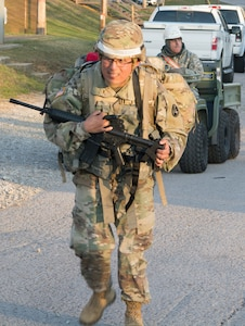 Assigned to the Fort Hood Regional Training Site-Maintenance, 3rd Brigade, 94th Training Division, Sgt. 1st Class Fabian Balarezo pushes himself to the 7.5-mile ruck march finish line as part of the 80th Training Command's 2018 Best Warrior Competition at Fort Knox, Kentucky, April 12, 2018. (U.S. Army Reserve photo by Maj. Addie Leonhardt, 80th Training Command)