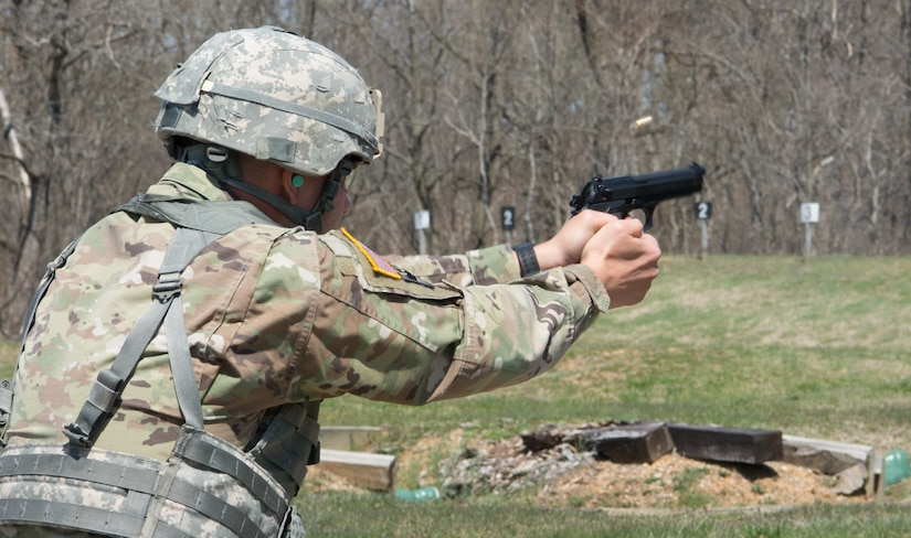 An Army Reserve Soldier fires a 9mm pistol at the weapons qualification range as part of the 80th Training Command's 2018 Best Warrior Competition at Fort Knox, Kentucky, April 12, 2018. (U.S. Army Reserve photo by Maj. Addie Leonhardt, 80th Training Command)