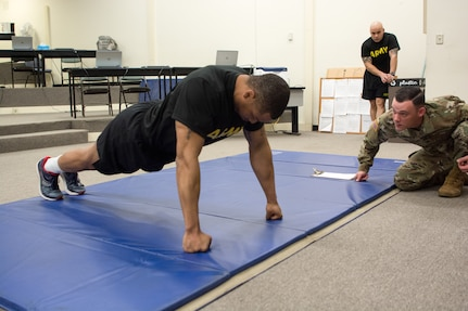 Staff Sgt. DeMarko Snow, assigned to Fort Dix Noncommissioned Officer Academy, 83rd U.S. Army Reserve Readiness Training Center, 100th Training Division, goes hard core on push-ups for the physical fitness test as part of the 80th Training Command's 2018 Best Warrior Competition at Fort Knox, Kentucky, April 13, 2018. (U.S. Army Reserve photo by Maj. Addie Leonhardt, 80th Training Command)