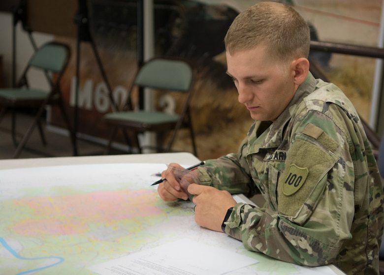 Staff Sgt. Ethan Kruger, with the Camp Parks Noncommissioned Officer Academy,  83rd U.S. Army Reserve Readiness Training Center, 100th Training Division, puts his map-reading skills to the test at the 80th Training Command's 2018 Best Warrior Competition at Fort Knox, Kentucky, April 13, 2018. (U.S. Army Reserve photo by Maj. Addie Leonhardt, 80th Training Command)