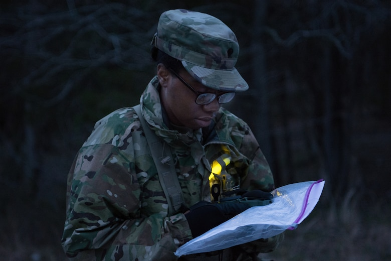 Spc. Alexis Colvin, with the 13th Battalion, 108th Ordnance Regiment, 3rd Brigade, 94th Training Division, plans her strategy for night land navigation as part of the 80th Training Command's 2018 Best Warrior Competition at Fort Knox, Kentucky, April 14, 2018. (U.S. Army Reserve photo by Maj. Addie Leonhardt, 80th Training Command)