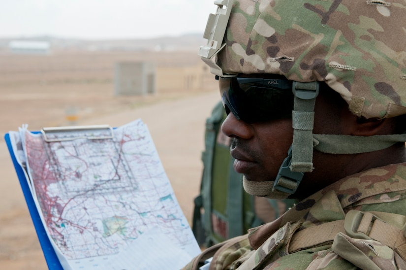 American Spc. Jason Durant, forward observer, Headquarters and Headquarters Battery, 1st Battalion, 143rd Field Artillery Regiment, discusses the simulated battlefield where Jordanian and U.S. forces were practicing calling for indirect fire during an exercise at Jordan's Joint Training Center near Amman, Jordan, April 11, 2018. The bilateral training was part of the Jordan Operational Engagement Program and focused on the exchange of infantry tactics and techniques.