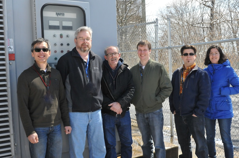 Members of the Tunnel 9 team are pictured with the electrical rectifier unit recently put into use. The unit, which was first delivered and installed in 2011, will replace an approximately 50-year-old power unit at Tunnel 9. Pictured from left are Electrical/System Engineer Tao Lee, Controls Engineer/Lead Controls Technician Ray Schlegel, Lead Electrician Ed Tierney, Chief Facility Engineer Nick Fredrick, Electrical/Data System Engineer Joel Barr and Test & Evaluation Engineer Inna Kurits.