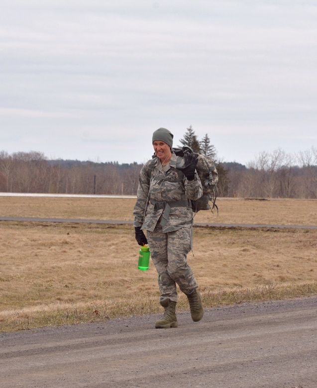 Staff Sgt. Stephanie Lambert, 109th Airlift Wing Public Affairs photojournalist, completes the ruck march portion of the German Armed Forces Forces Proficiency Badge on April 14, 2018, at Stratton Air National Guard Base, Scotia, New York. She completed 3.73 miles in just under 1 hour carrying 33 pounds in her rucksack.