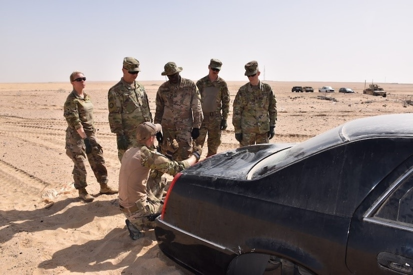 Cpl. John Bradshaw of the 797th Explosive Ordnance Disposal (EOD) Company of Fort Hood, Texas explains to the Combat Engineers of the Missouri National Guard's 35th Engineer Brigade a way to breach the trunk of a vehicle.