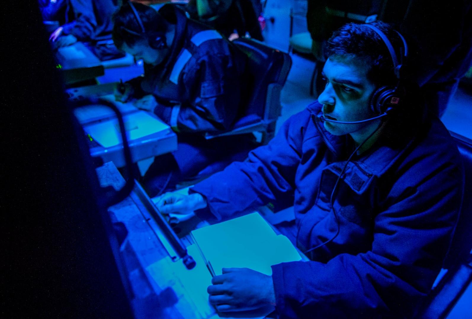 A U.S. Navy Sonar Technician monitors sonar equipment.