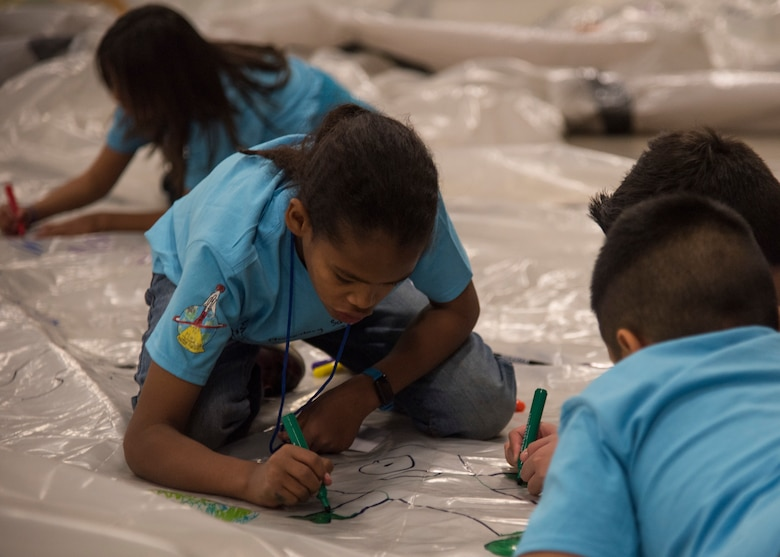 Students from local Albuquerque schools participate in Air Force Research Lab's Mission to Mars at the Albuquerque Convention Center in Albuquerque, N.M., April 20. The Mars Missions flight provides fifth grade students an opportunity to plan and carry out a simulated manned mission to Mars, their objective is to build a colony of habitats that can sustain life.