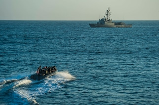 A small US Navy boat maneuvers in the Pacific.