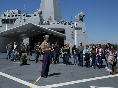 Maj. Brooks W. Boehlert addresses guests before Oregon Navy and Marine Corps enlistees recite the Oath of Enlistment aboard the future USS Portland (LPD 27) in Portland, Oregon, April 19, 2018. Portland is the U.S. Navy's 11th San Antonio-class amphibious transport dock ship. It is the third ship to bear the name USS Portland; however, it is the first ship to be named solely for Oregon's largest city. Boehlert, from Siletz, Oregon, is the commanding officer of Recruiting Station Portland, Oregon. (U.S. Marine Corps photo by Sgt. Steven Tran)