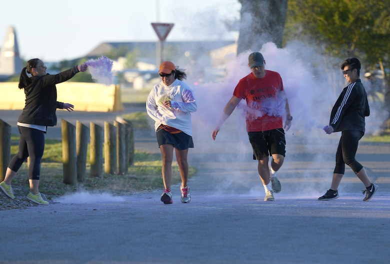 Keesler personnel participate in the Air Force Assistance Fund Color Run at Keesler Air Force Base, Mississippi, April 20, 2018. The AFAF raises funds for charitable affiliates that provide support to Air Force families in need. (U.S. Air Force photo by Kemberly Groue)