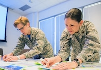 U.S. Air Force Maj. Emily Roark, right, 60th Medical Group and Col. Elizabeth Decker, Air Force Medical Service, prepare story boards for their presentation during the Transdisciplinary Evidence Based Practice Conference at NorthBay Healthcare Medical Center, Fairfield, Calif., April 13, 2018. The goal of the Transdisciplinary Evidence Based Practice Conference is to improve care based on clinical expertise, patient preference, and evidence. (U.S. Air Force photo by Louis Briscese)