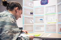 U.S. Air Force 1st Lt. Leigh Cannon, 60th Inpatient Squadron, Travis Air Force Base, Calif., prepares a story board for her presentation during the Transdisciplinary Evidence Based Practice Conference at NorthBay Healthcare Medical Center, Fairfield, Calif., April 13, 2018. The goal of the Transdisciplinary Evidence Based Practice Conference is to improve care based on clinical expertise, patient preference, and evidence. (U.S. Air Force photo by Louis Briscese)