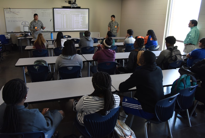 U.S. Air Force Capts. Jonathan Han and Vincent Taylor, 333rd Training Squadron cyber warfare instructors, conduct a wireless hacking demonstration during DuckCon for Gulfport High School students in Gulfport, Mississippi, April 20, 2018. The off-base technology exhibit focused on cyber topics such as wireless security, programming, cyber careers, and internet/web vulnerabilities. The purpose of the event was to spark interest in science, technology, engineering and mathematics programs. (U.S. Air Force photo by Kemberly Groue)