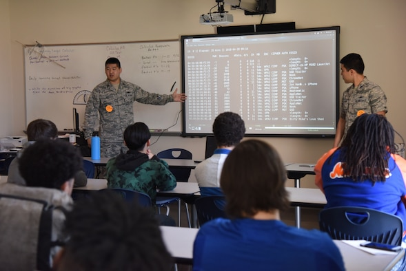 U.S. Air Force Capts. Jonathan Han and Vincent Taylor, 333rd Training Squadron cyber warfare instructors, conduct a wireless hacking demonstration during DuckCon for 