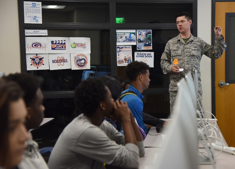 U.S. Air Force Tech. Sgt. Jacob Conrads, 333rd Training Squadron cyber warfare instructor, delivers an introduction to computer programming during DuckCon for Gulfport High School students in Gulfport, Mississippi, April 20, 2018. The off-base technology exhibit focused on cyber topics such as wireless security, programming, cyber careers, and internet/web vulnerabilities. The purpose of the event was to spark interest in science, technology, engineering and mathematics programs. (U.S. Air Force photo by Kemberly Groue)