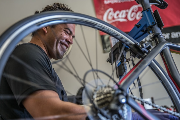 Pains, gains, and bike chains: U.S. Marine Corps wounded warrior gives back to injured brothers and sisters-in-arms