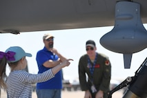 A child asks a question about the MQ-9 Reaper model during the 2018 Wings over Columbus Air and Space Expo April 21, 2018, at Columbus Air Force Base, Mississippi. The event marked the MQ-9's first stop for the airshow season. (U.S. Air Force photo by Senior Airman James Thompson)