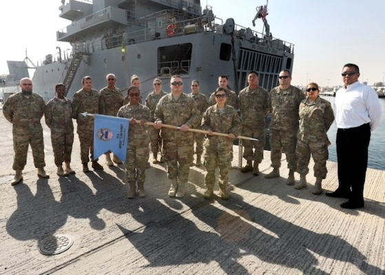 Army Lt. Col. Paul V. McCullough III (center) and Air Force Master Sgt. Romelia Jackson (second from left) stand with the DLA Support Team in a unit photo. McCullough and Jackson both deployed for six months before returning to their duties with DLA Troop Support's Construction and Equipment supply chain.