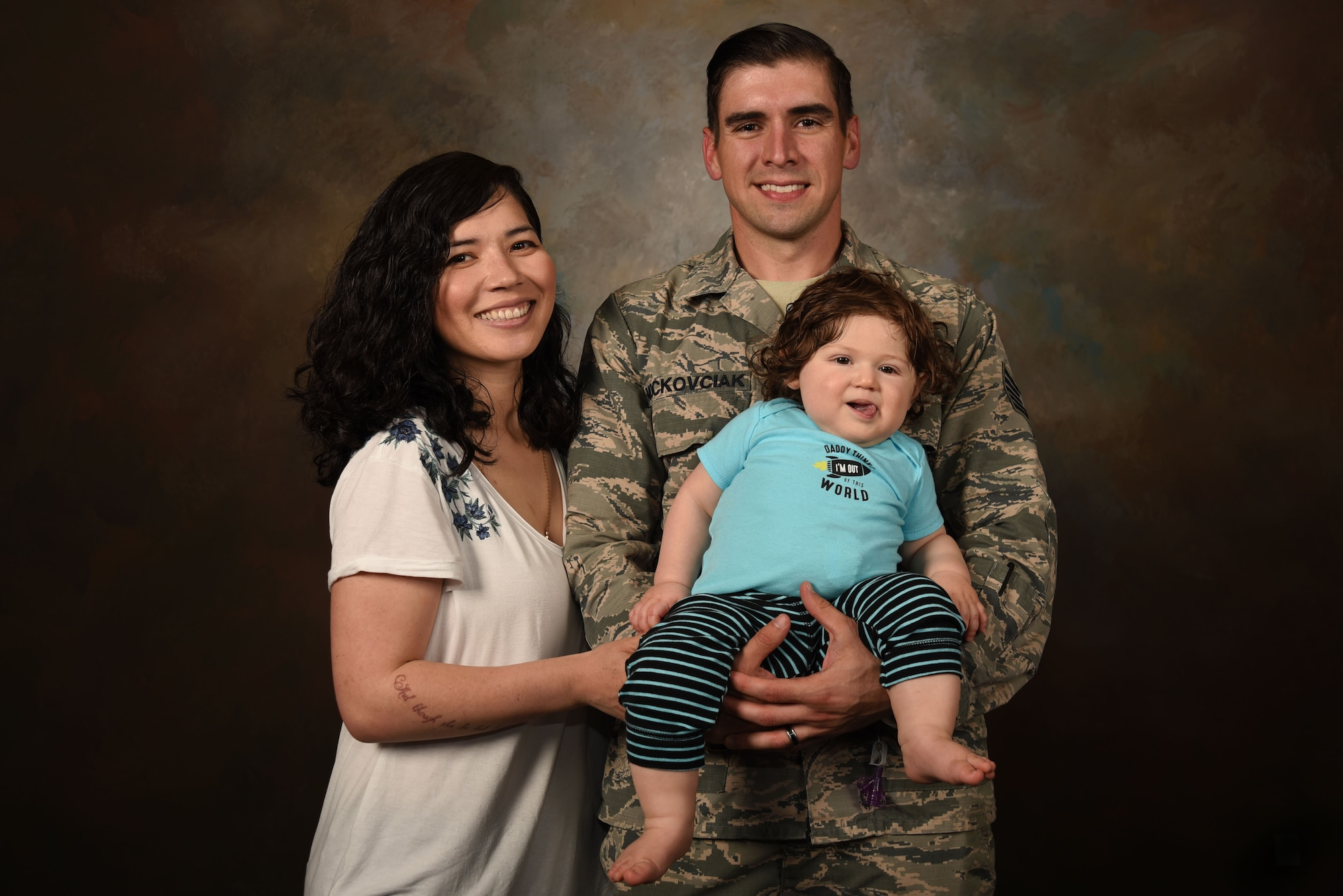 U.S. Air Force Tech. Sgt. Ben Mockovciak, 372nd Training Squadron Detachment 202 F-16 tactical aircraft maintenance instructor, right, and Ashley Mockovciak, Team Shaw spouse, left, stand with their son, Noah Mockovciak, at Shaw Air Force Base, S.C., April 24, 2018.