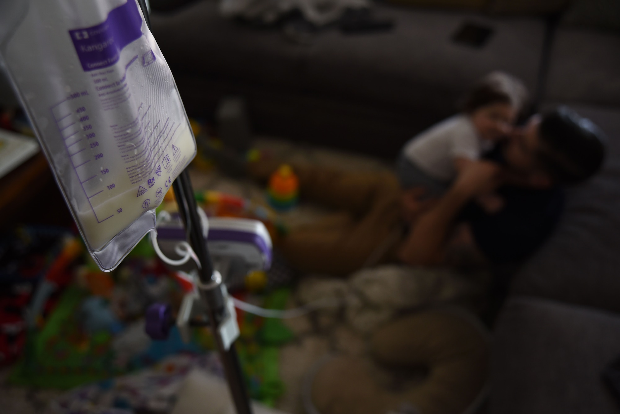 U.S. Air Force Tech. Sgt. Ben Mockovciak, 372nd Training Squadron Detachment 202 F-16 tactical aircraft maintenance instructor, plays with his son, Noah Mockovciak, as Noah is fed through a gastrostomy tube in their home at Columbia, S.C., March 15, 2018.