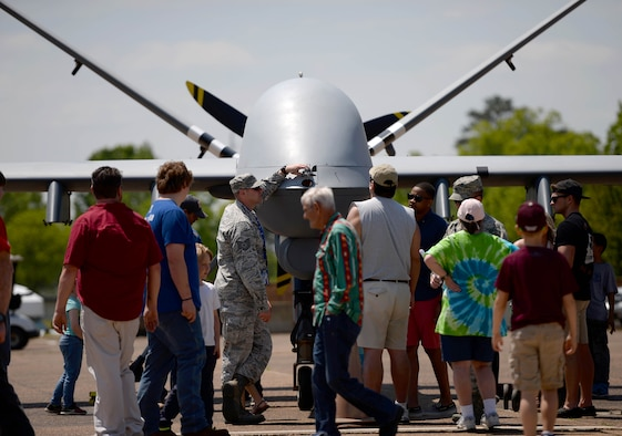 Airmen assigned to the 432nd Wing/432nd Air Expeditionary Wing from Creech Air Force Base, Nev., speak to the attendees of the 2018 Wings Over Columbus Air and Space Show about the MQ-9 Reaper and it's capabilities April 21, 2018, at Columbus Air Force Base, Mississippi. This was the first Air Force event the MQ-9 and its aircrew attended during the 2018 season and marked the first time the aircraft was at Columbus Air Force Base. (U.S. Air Force photo by Airman 1st Class Keith Holcomb)