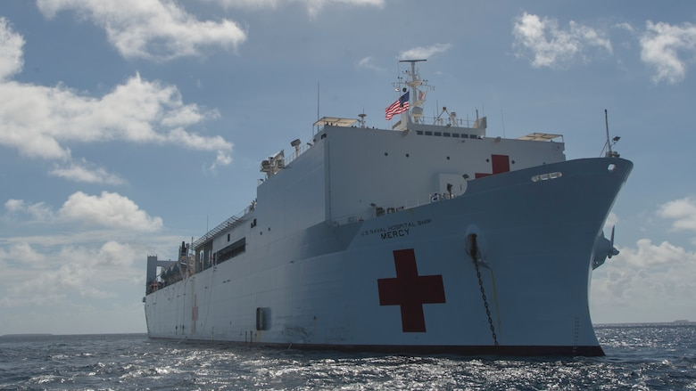 PACIFIC OCEAN (March 20, 2018) Military Sealift Command hospital ship USNS Mercy (T-AH 19) anchors in waters near the Ulithi Atoll while en route for its first mission stop of Pacific Partnership 2018 (PP18).
