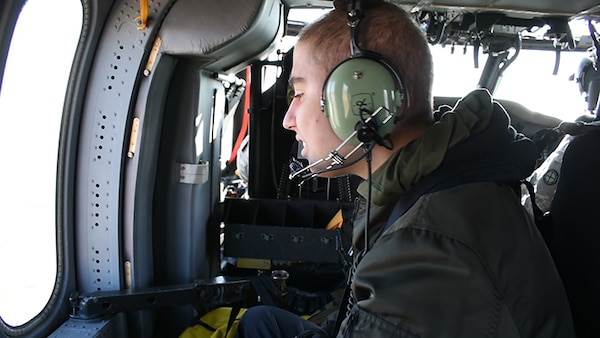 Seth Cummings flies above Topeka, Kansas, aboard a Black Hawk helicopter from the 1st Battalion 108th Aviation Regiment as part of a Make-A-Wish  foundation dream come true on March 30, 2018.
