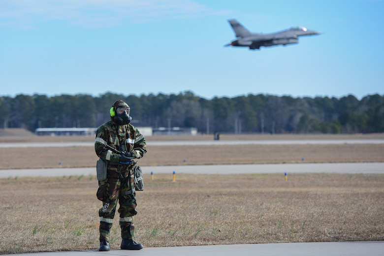 U.S. Air Force Airmen, assigned to the South Carolina Air National Guard's 169th Fighter Wing, participate in an exercise that measures the ability to survive and operate in chemical warfare equipment at McEntire Joint National Guard Base, S.C., Feb. 3, 2018. Swamp Fox Airmen continue to hone routine skills to meet combatant command requirements. The muscle memory that is formed by using this equipment multiple times allows Airmen the ability to focus their attention on completing the mission under austere conditions. (U.S. Air National Guard photo by Senior Airman Megan Floyd)