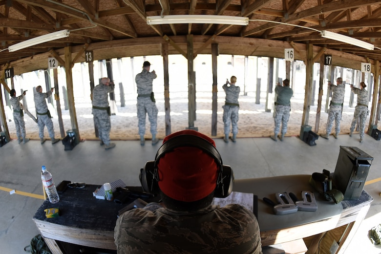 U.S. Air Force Staff Sgt. Andre Buck, a Combat Arms Training and Maintenance instructor with the 169th Security Forces Squadron at McEntire Joint National Guard Base, South Carolina Air National Guard, gives instructions during M-9 pistol qualifications at the base shooting range, April 6, 2018. Swamp Fox Airmen continue to hone routine skills to meet combatant command requirements. The muscle memory that is formed by using this equipment multiple times allows Airmen the ability to focus their attention on completing the mission under austere conditions. (U.S. Air National Guard photo by Master Sgt. Caycee Watson)