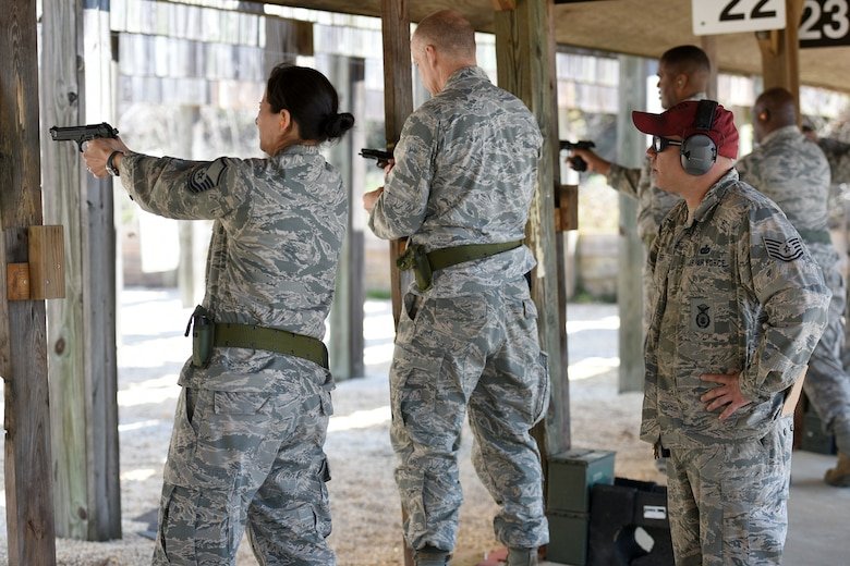U.S. Air Force Tech. Sgt. Ismael Fierro, a Combat Arms Training and Maintenance instructor with the 169th Security Forces Squadron at McEntire Joint National Guard Base, South Carolina Air National Guard, monitors Airmen during M-9 pistol qualifications at the base shooting range, April 6, 2018. Swamp Fox Airmen continue to hone routine skills to meet combatant command requirements. The muscle memory that is formed by using this equipment multiple times allows Airmen the ability to focus their attention on completing the mission under austere conditions.  (U.S. Air National Guard photo by Master Sgt. Caycee Watson)
